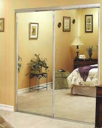 rummy double mirrored closet doors with elegant dresser as well as shade table lamps in modern master bedroom inspirations