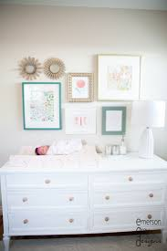 I love this, but navy and pale pink instead of coral and teal. Coral & Teal  Nursery with pops of gold - so chic! I love this gallery wall idea above  the ...