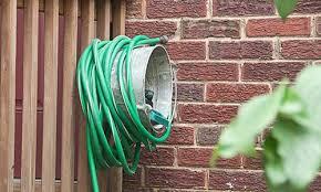 garden hose storage ideas. Metal Pail Turned Garden Hose Organizer Storage Ideas B