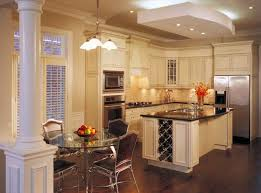 cabinet and lighting. Cream Cabinets Warm Up This Room Without Darkening It And Balances The Dark Floor Counters Cabinet Lighting K