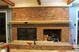 the finale to building a fireplace facade covering the brick adding shelves a cabinet and trim painting