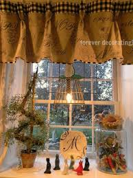 kitchen window with script fabric valance with check borders and short sheers