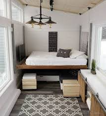 tiny home furniture. other clever tricks here include a builtin console at the center of home covered by sliding doors that can pull up into two desks or one longer tiny furniture n