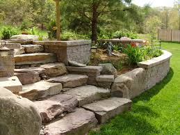 natural stone steps built into retaining wall garden