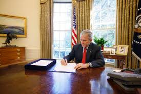 george w bush signs the emergency economic stabilization act of president george w bush signs the emergency economic stabilization act of 2008 in the oval office friday