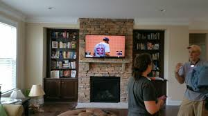 how much does it cost to mount a tv over the fireplace in charlotte nc