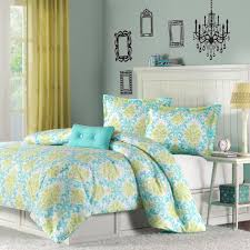 interior blue and yellow bedding set on white wooden bed connected by grey wall and