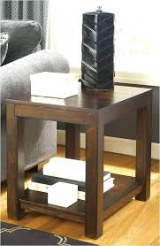 ashley coffee table sa round glass with 4 stools furniture canada signature design by canaan trunk