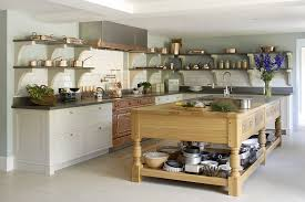 rustic island with open shelves floating kitchen shelves copper kitchen appliance copper electric range gray countertop on white cabinets