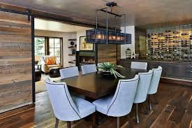 reclaimed wood sliding door rustic dining room dark wooden dining table gray dining chairs