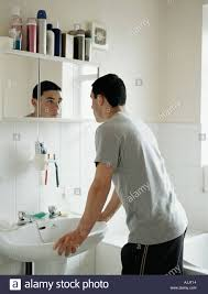 bathroom mirror reflection. Teenage Boy Standing In Bathroom - Stock Image Mirror Reflection I