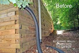 how to build a retaining wall with landscape timbers timber retaining walls building a retaining wall using landscape timbers