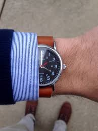 my black face and leather strap watch