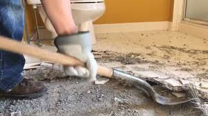 how to remove tiles from concrete floor