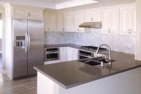 image of white cabinets with grey quartz countertops