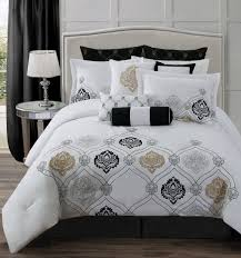 king size quilt with patterned black and white design also