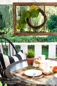 a fall patio wicker resign rattan table setting with old windows windsor chairs and