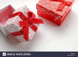 Decorative Holiday Boxes Two decorative gift boxes with red ribbon and hearts printed close 56