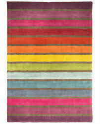 large brightly coloured rainbow pattern wool rug