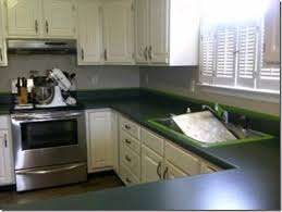 green laminate kitchen countertops with white cabinets
