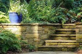 stacked stone wall and steps incorporate landscaping stones