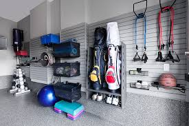 slat wall storage in a garage fitness room