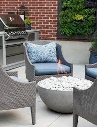 a round concrete fireplace warms modern