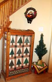 Awesome Log Cabin Christmas Tree Quilt Attached on Wooden Display ... & decoration awesome log cabin christmas tree quilt attached on wooden display  case with glass doors near Adamdwight.com