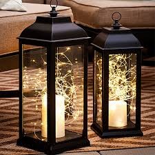 interior lantern lighting. White String Lights And LED Candles Inside Lanterns In An Outdoor Setting. Interior Lantern Lighting