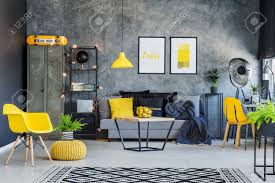 creative office interior design. Creative Office Interior With Gray Couch, Yellow Accents And Metal Furniture Stock Photo - 83344324 Design