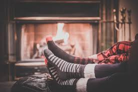 two people by the fireplace
