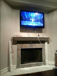 tv above fireplace wires how to hide the electrical wires to the big screen located above tv above fireplace wires fireplace tv wires