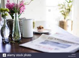 News Paper Flower Vase Newspaper Flower Vases Loudspeaker And Muffin On Table