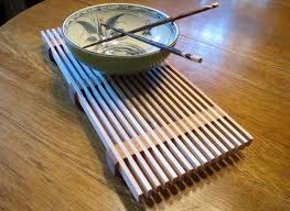 Here's a simple project that looks great, and could easily burn up some of  that scrap wood you've been hoarding for years. This elegant trivet will  grace ...