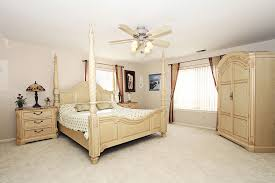 traditional bedroom furniture. Modren Bedroom Cream Bedroom Furniture In Luxury Traditional With A Fan Plus  Ceiling Lights On Top Near Large Window Decorated Tiffany Lamps And Painting  On