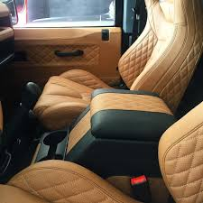 quilted leather interior on the defender custom made in tan with black stitching
