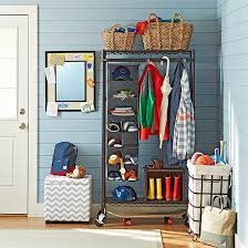 Coat Rack Solutions organized entryway with a rolling coat rack closet and baskets 100 59