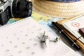 Travel Calendar Diary And Calendar With Passport Travel Planning Stock Photo