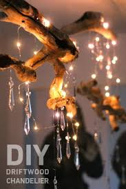 contrast driftwood with crystal for this chandelier