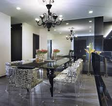 modern eclectic hollywood regency dining room with glossy black chandelier black glossy lacquer dining table and damask dining room chairs with lucite