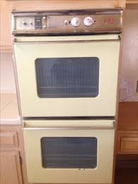 antique gas stoves late 1950 s gaffers sattler yellow vintage waste king universal not sure about this for an oven company