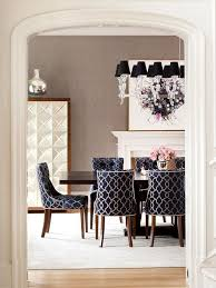 from the custom metal front cabinets to the silver nailhead trim on the chairs this dining room is rooted in sleek sophistication