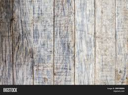 rustic wood floor background. Bright Grungy Grey Wooden Floor Photo Background. Rustic Wood Plank Closeup. Silver Background G