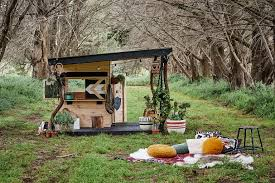 we have long brought you our cubby houses made from recycled apple crates a beautifully rustic greyed off timber that shows through its stencils