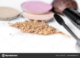 mascara beige powder for face eye shadow and makeup brush on the white background natural makeup photo by erstudio