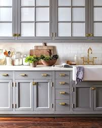gray cabinets gray cabinets with white subway tile and brass hardware gray kitchen cabinets white countertops