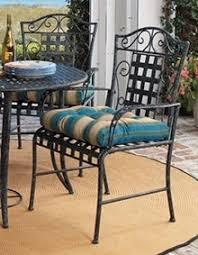 Wrought iron patio chairs Metal Porch Ocom Fivepiece Wrought Iron Patio Set Bob Vila Fall Maintenance Bob Vila How To Winterize Your Patio Furniture Bob Vila