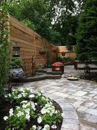 Wonderful Concept Of Small Backyard Using Garden Lamp And White Flowers  Create Your Beautiful Gardens With