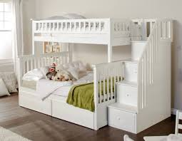 This pristine white painted bunk bed features a large full size lower bunk,  with hidden