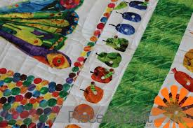 Piece N Quilt: Hungry Caterpillar Quilt & After checking it out I came up with the perfect edge to edge pattern,  Numeral, if you look closely you can see numbers quilted into the quilt. Adamdwight.com